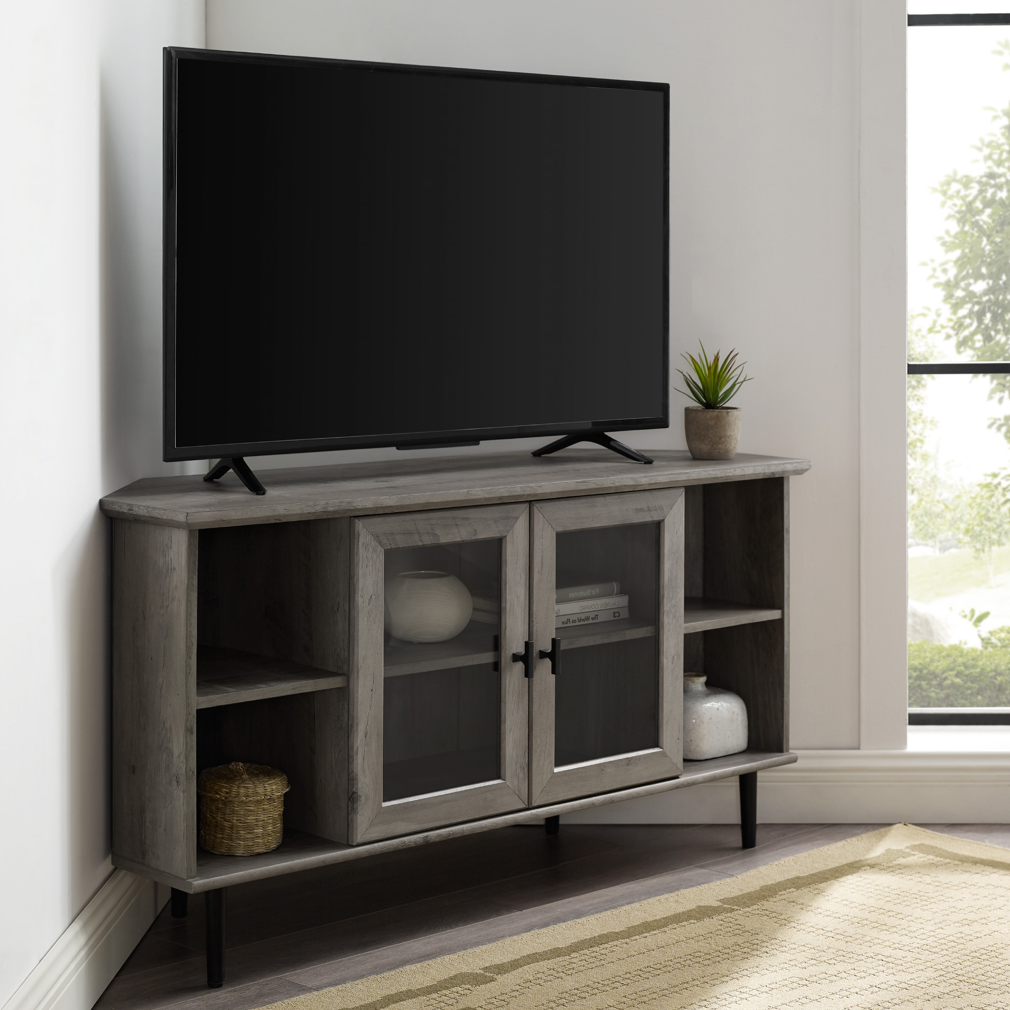 Manor Park Glass Door Corner Tv Stand For Tvs Up To 55 Throughout Delphi Grey Tv Stands (View 1 of 20)