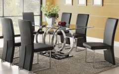 Glass Dining Tables and 6 Chairs