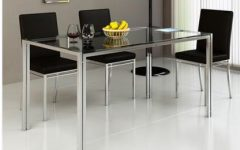 Glass and Stainless Steel Dining Tables